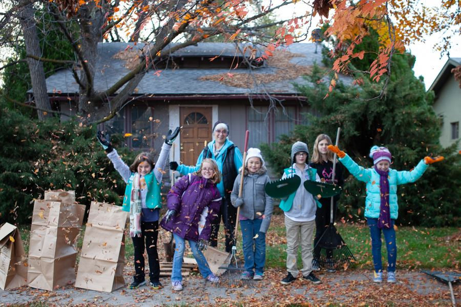 Local Girl Scout Group volunteers for Rake Up Nampa 2018 - jumping in air