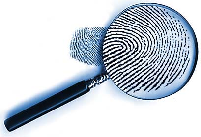 Picture of a magnifying glass viewing a fingerprint