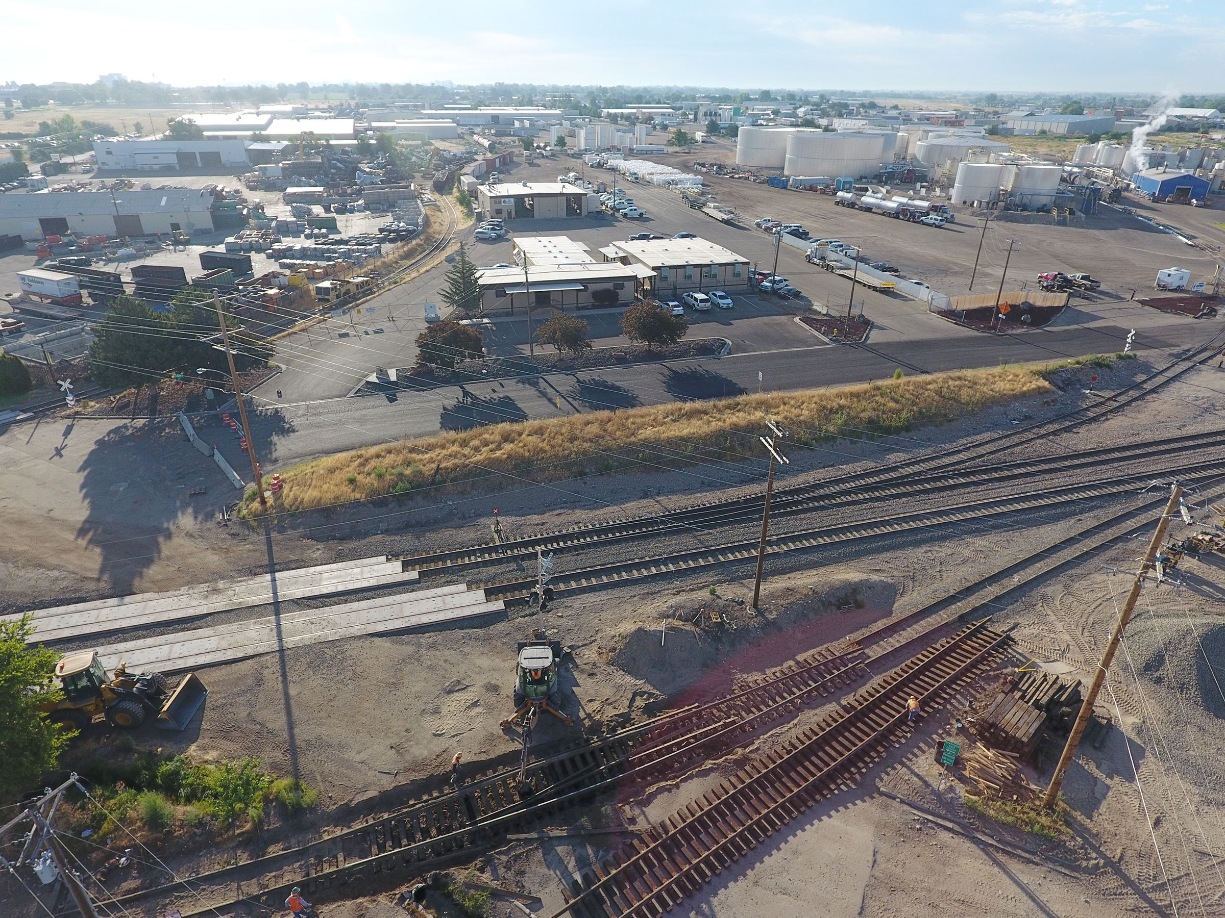 A drone shot of 11th Ave North intersection at the railroad tracks