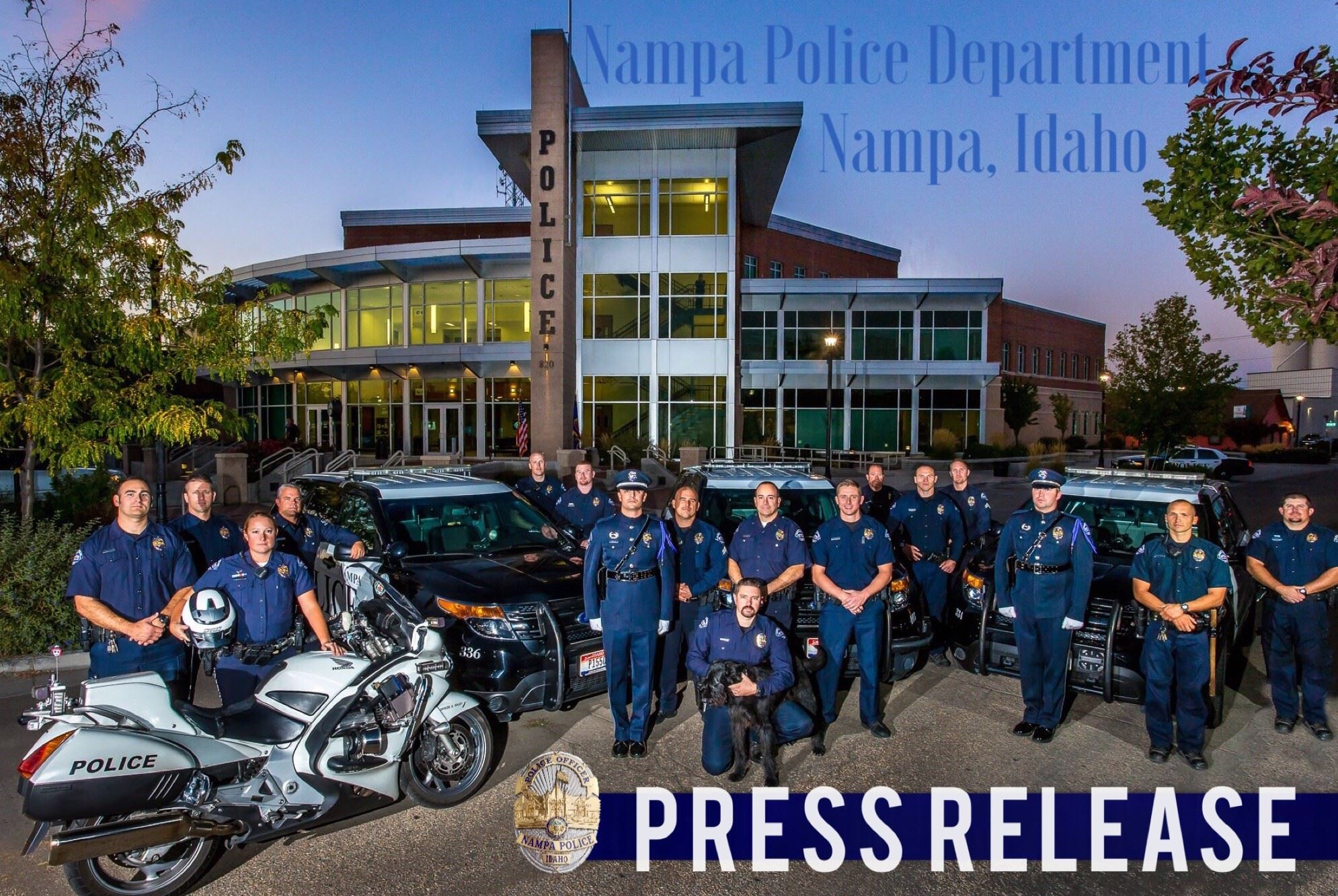 Several Nampa Police Officers in uniform in front of the Nampa Police Station and the words press re