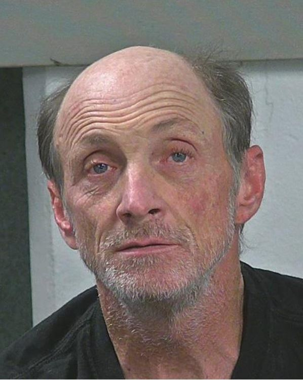 Photo of suspect, Jack R. Swisher.