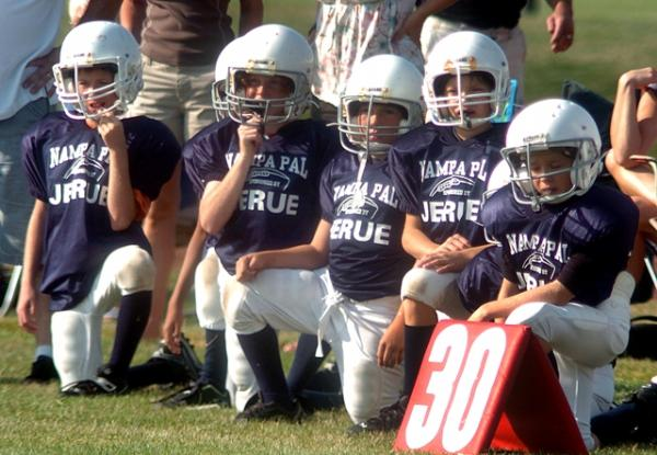 Photo of children in football uniforms